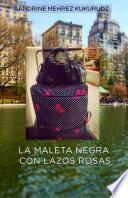 La maleta negra con lazos rosas